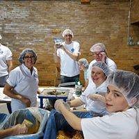 Kiwanis volunteers preparing meals in support of Feed My Starving Children