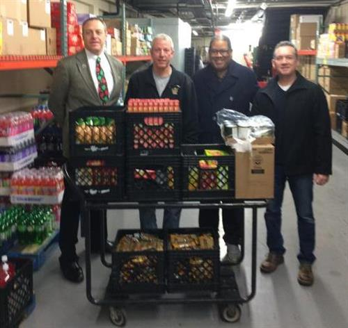 Right at Home helps with North Ave. Business Assoc. Christmas Food Drive
