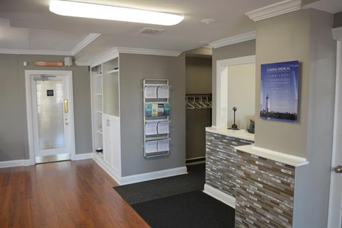 Entry area to Suite 600 with literature and brochures.