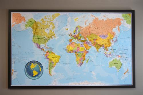 Map in the waiting room with pins showing the places around the world where patients travel from to receive treatment.