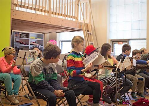 We offer vibrant music and art programs for all students.