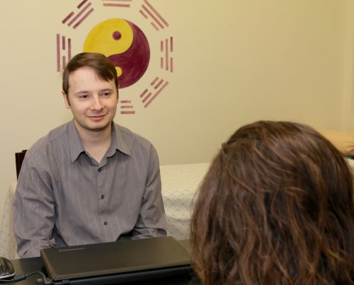 Nick talking to a patient before a treatment