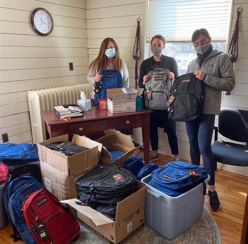 Volunteers prepare 30 backpacks monthly for returning citizens