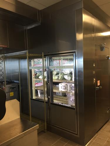 Walk in cooler with glass door section reach in