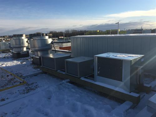 Installation of condensing units for ice machine, walk-in cooler, and walk-in freezer.