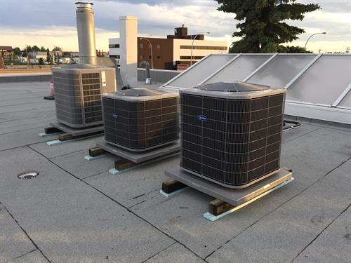 Carrier AC condensing units for a system retrofit.  Upgraded system from R22 to R410a