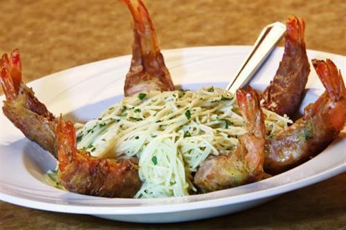 Prosciutto Wrapped, Garlic Stuffed Shrimp served over Capellini