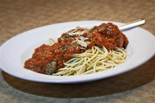 The Classic Spaghetti Bolognese served with our Home-made Meatballs