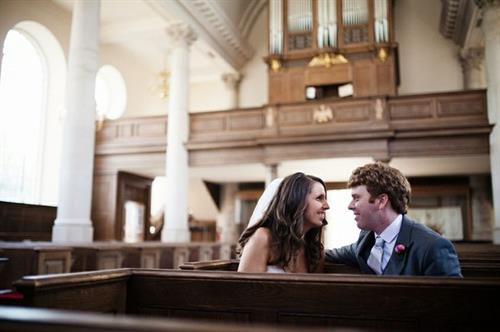 Gallery Image Churchill_Wedding_Couple_in_Pews.jpg