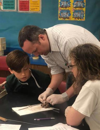 Dr. Wade demonstrates dissection.