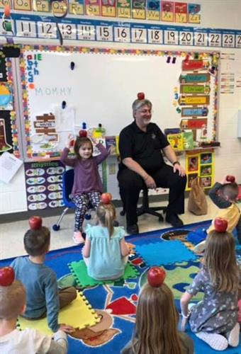 Pastor Kelling pays a classroom visit.