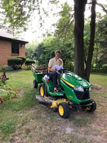 Gallery Image Erik._his_little_guy._and_the_John_Deere.jpg