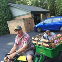 Gallery Image Rides_on_the_John_Deere_at_summer_office_party.jpg
