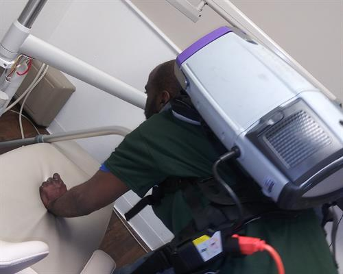Vacuuming Of Patient Room Chair