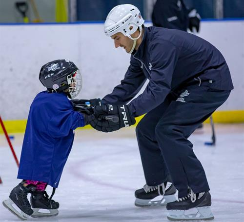 Youth Learn to Play Hockey
