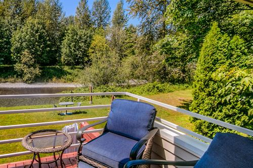 Watch the River Flow By from your private Moon River Suites Balcony