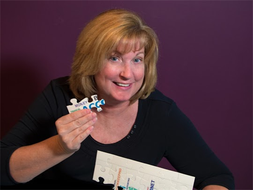 Gallery Image Leigh_holding_puzzle_piece.png