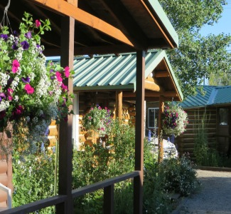 Private porches, beautiful hanging baskets, free-standing cabins