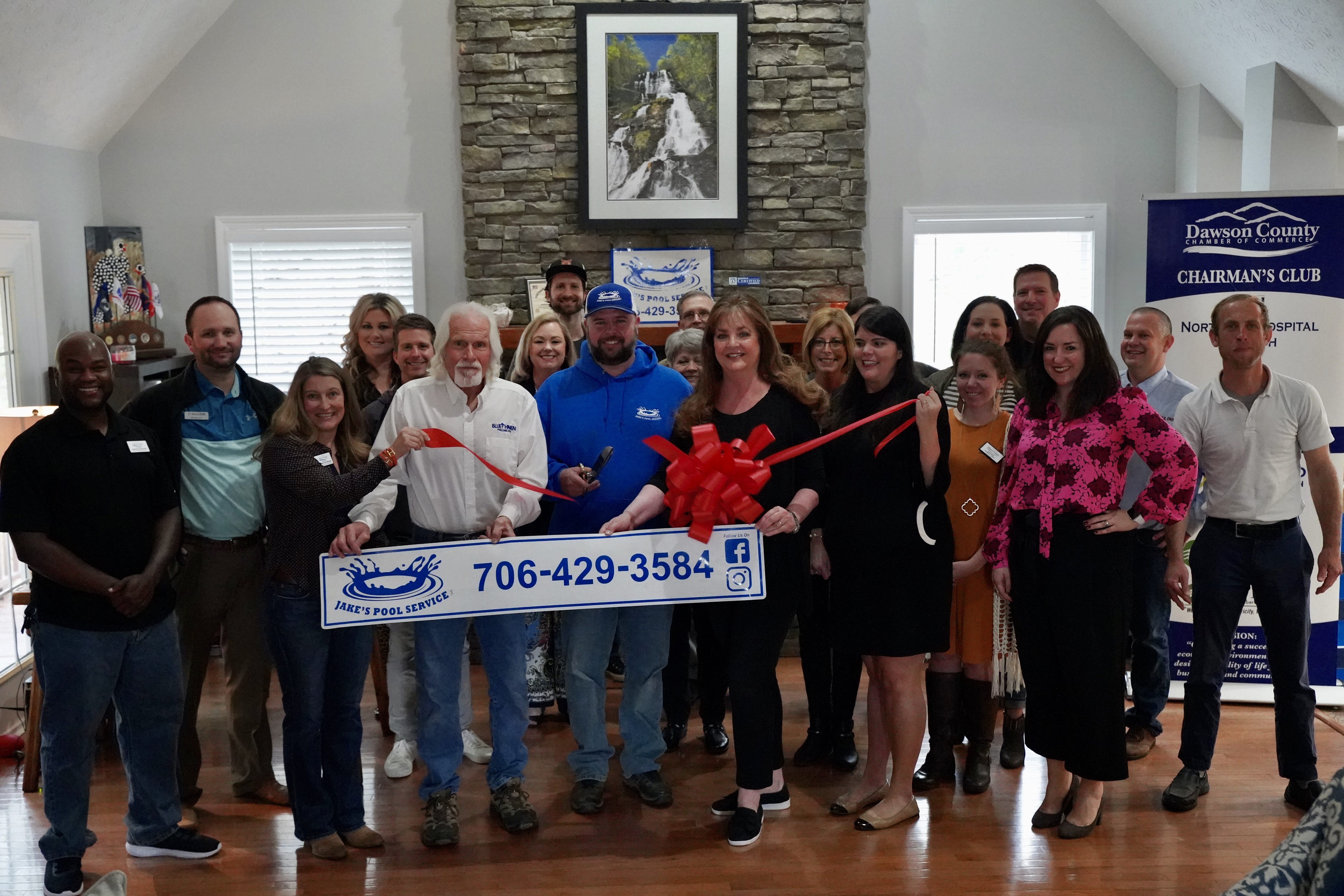 Ribbon cutting ceremony with Jake's Pool Service!