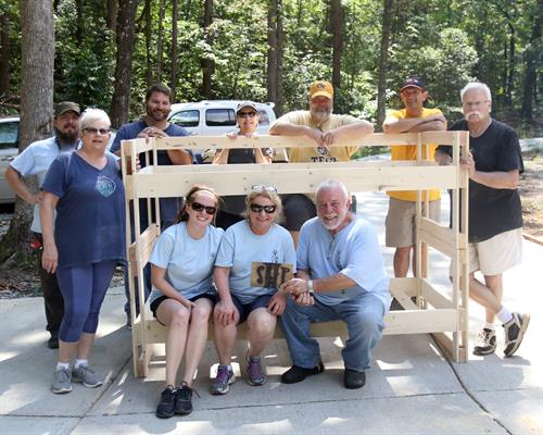 Not only is building beds helping kids in our town, it's an excellent team-building activity! (Thank you Jessica Brown of the Dawson News!)