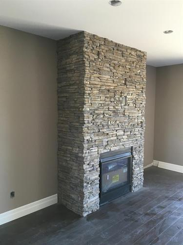 Stacking stone on gas fireplace