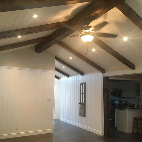 New addition with exposed pine beams and rafters