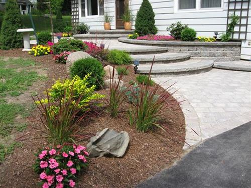 Elegant front walkway and gardens