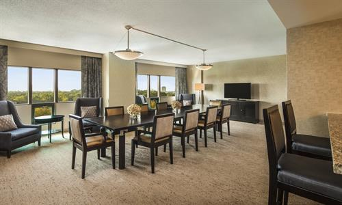 Hospitality suite with large dining table, ideal for a meeting or a family gathering. The Hospitality suite has a wet bar and two adjoining rooms.