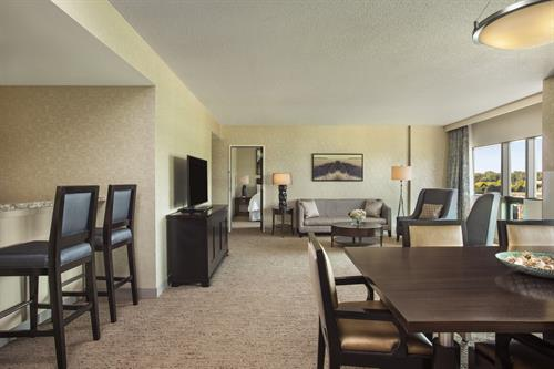 Hospitality suite with a wet bar, dining area and soft seating. The suite used as is or book the adjoining king or room with two double beds.