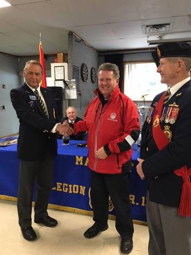Receiving donation from Malahat Legion