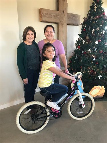 Look at the joy on this sweet girls face when she received a donated bicycle!