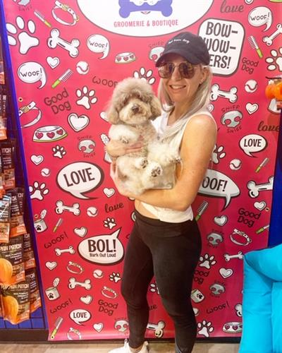 Come take a picture with your fur baby at our Selfie wall!