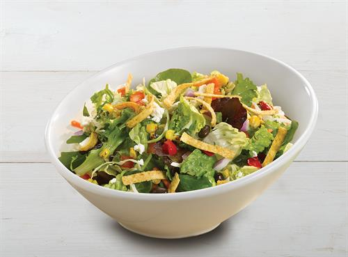 Our Southwest Santa Fe Salad contains rotisserie chicken with poblano pepper & black bean relish, tortilla strips, chipotle cheddar dressing, and more.