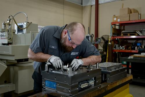 A Toolmaker at Flowrite in Grand Rapids