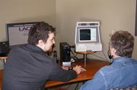Craig Van Doorne performing real ear testing to verify programming of a hearing device.