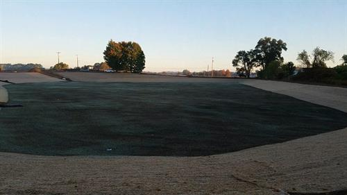 The newly excavated stormwater detention basin serving the new sports complex at Byron Center West Middle School