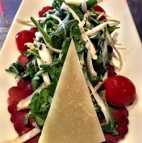 Bresaola, arugula and endive salad with Manchego cheese and black truffle dressing