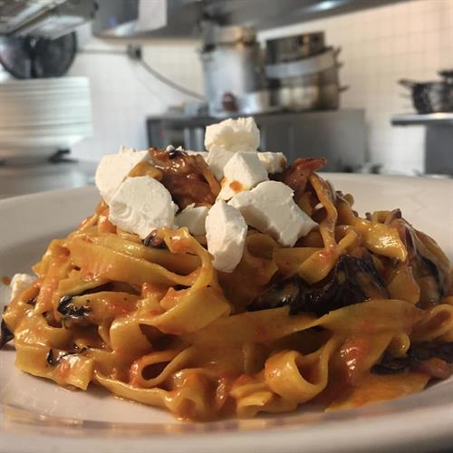 Homemade tagliatelle with radicchio, speck and goat cheese
