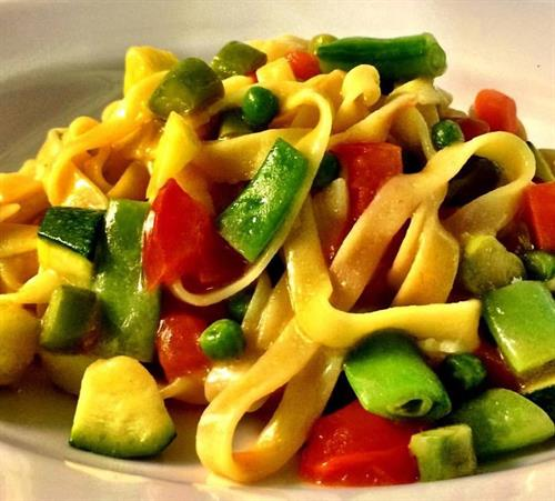 Homemade gluten free tagliatelle with seasonal vegetables
