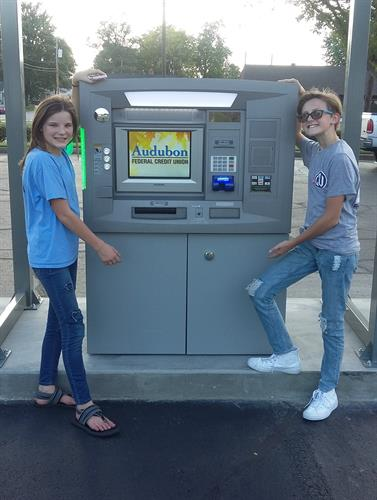 Members, Karlie and Grace introducing the New ATM Machine.