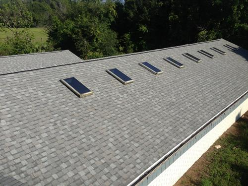 Skylight installation on a shingle roof.