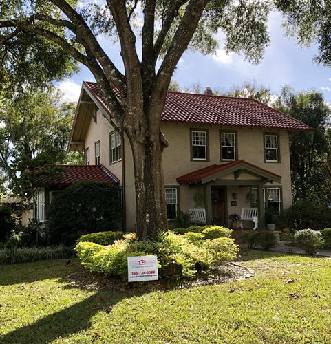 Metal-tile roof installation on a historic home in DeLand.