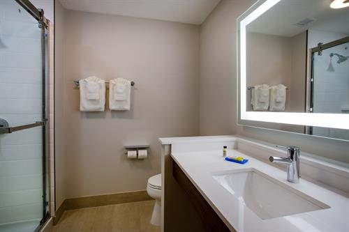 Well lit and spacious bathrooms with built in amenities.