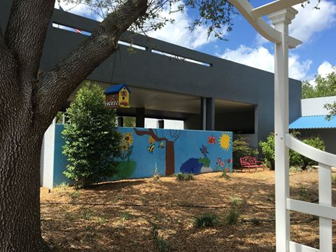Mural in our butterfly garden, painted by our students