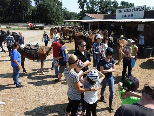 Horseback family riding