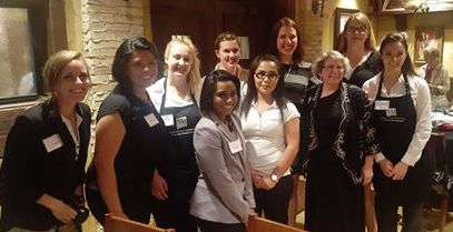 Secretary of Tourism Rebecca Latham with HRTM students