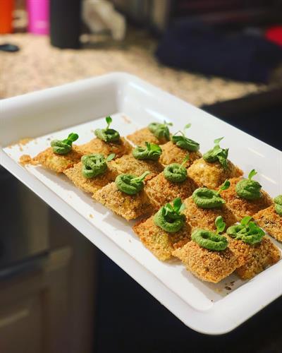 Baked ravioli with pesto