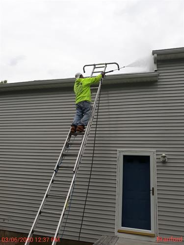 Cleaning the roof and siding with the power washer!