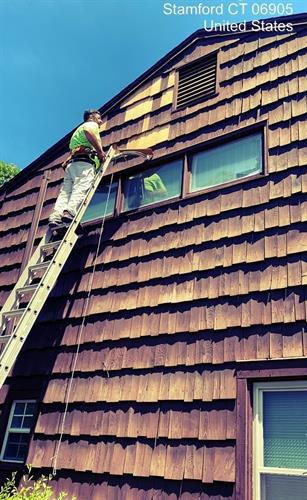 Exterior painting prep for this shingle siding.