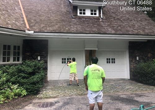 Power washing to prep for exterior painting.
